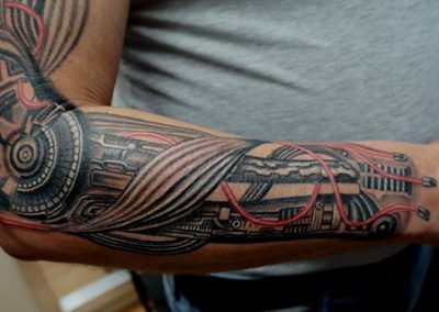 Mechanic arm tattoo