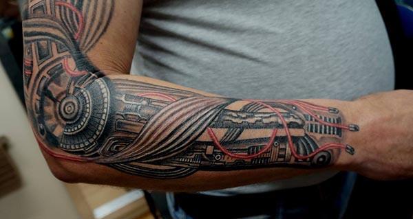 Mechanic arm tattoo