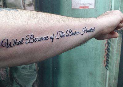 Tekst lettering tattoo