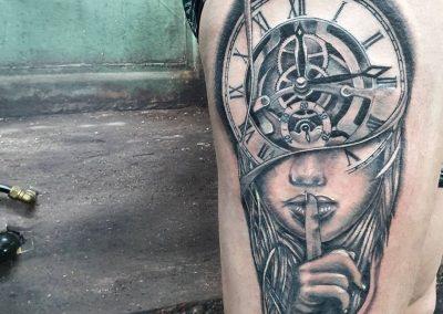 Realistic woman/clock tattoo